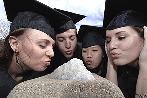 Graduates pucker up  to receive the gift of eloquent speech from Texas Tech's very own Blarney Stone.
