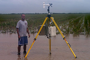 Team member Brian Hirth, an atmospheric science doctoral student, stands with a  Stick-Net probe  following Hurricane Dolly in South Texas, July 2008.