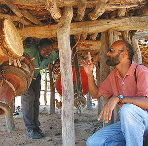 Fulbright recipient Joseph Aranha studies a hut as part of his research into non-western vernacular architecture.