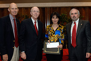 Natalia Kolyesnikova, College of Human Sciences, is one of eight new faculty members honored by the Texas Tech Alumni Association. (L-R) TTAA Executive Vice President and CEO Bill Dean, Chancellor Kent Hance, Kolyesnikova, President Guy Bailey.
