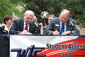 TTU President Guy Bailey and WTC President Mike Dreith sign the Student Access and Success Partnership Sept. 11 at Western Texas College.