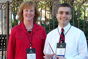 The Red to Black program received the Outstanding Financial Counseling Center Award, which was accepted by Dorothy Durband, director of the program, and Ryan Law, a Red to Black Graduate Assistant.
