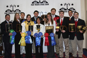 Meat judging team with ribbons and awards.
