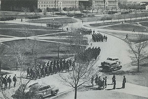 Cadets march from classrooms to barracks around Memorial Circle in April 1944. Image from