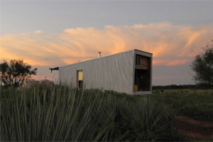 The Sustainable Cabin was constructed from the recycled metal chassis of a double-wide mobile home.