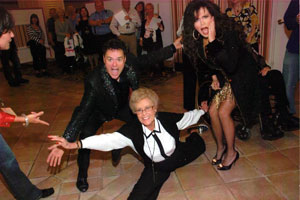 Kuykendall doing the splits while Donny and Marie Osmond look on.