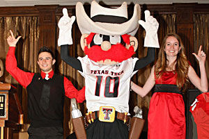 Cody Crea and Karina Perry were revealed and honored for their duties as Raider Red during the Passing of the Guns ceremony.