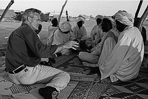 Pelley with Darfur refugees in 2006.
