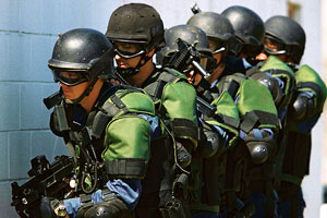 United States Customs and Border Protection officers, fully armed and armored for a counter-terrorism operation.