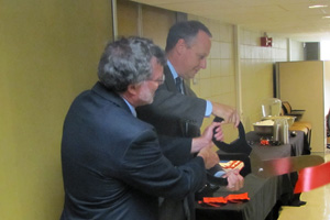 Greg Gellene, associate chair for the Department of Chemistry and Biochemistry, and Taylor Eighmy cut the ceremonial ribbon to officially open the room.