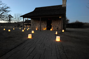 Luminarias light the paths around the historic structures where volunteers recreate holiday scenes of the past.