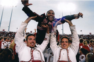 Hill, center, served as drum major of the Goin' Band From Raiderland and received his bachelor's and master's degrees from Texas Tech.