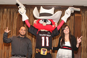 Jordaine Holden and Erik Gonzalez were honored for their service as Raider Red during the Passing of the Guns ceremony.