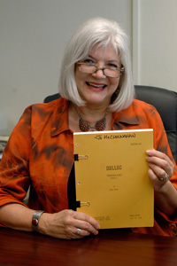Moore, holding an original script from the show, became a production assistant for