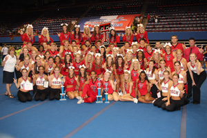 The cheerleading and pom squads pose with their trophies following another successful showing at camp.