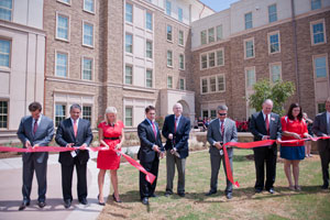 Chancellor Kent Hance, center, and other Texas Tech administrators participate in a ribbon-cutting ceremony to officially open the Boston Avenue Residence Hall.