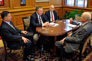 Representatives from the Department of Defense met with Chancellor Kent Hance on their visit to Texas Tech.