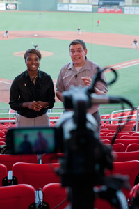 Erica Taylor and Joshua Koch introduce the first segment of the Double T Insider during stand ups inside the Dan Law Field at Rip Griffin Park.