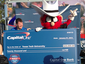 Raider Red receiving the $20,000 grand-prize check that will go toward Texas Tech's mascot program.