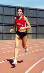 Two years after taking up running in high school, Leigh received a scholarship to Texas Tech.