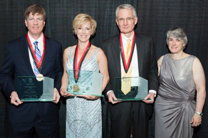 From left to right, Kevin Glasheen, Sue Walker, William Dawson and School of Law Dean Darby Dickinson