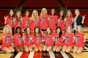 The new 18-member pom squad, with coach Erin Harold, far right. (Click photo to enlarge.)