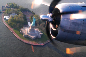 B-29 Superfortress flies past Statue of Liberty