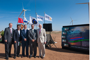 Texas Tech chancellor Kent Hance, far right, and presdient M. Duane Nellis, far left, post with officials from the Department of Energy, Sandia National Laboratories and Vestas.