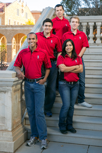 Members of the Texas Tech chess team, along with coach Alex Onishuk, far back.