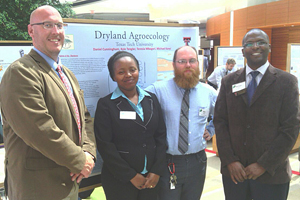 The students presenting their research at the Wisconsin Institute of Discover.