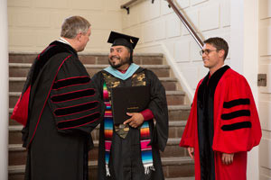 Sedeño receives diploma from President Nellis.