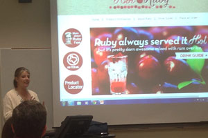 Assistant Professor Erica Irlbeck delivers a message about social media at a recent seminar.
