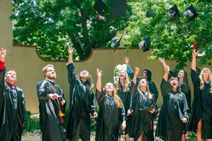 Members of the 2014 TTUISD graduating class celebrate their accomplishment.