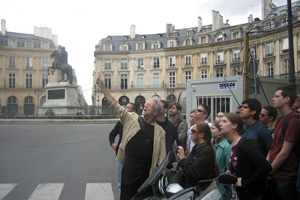 College of Architecture Dean Andrew Vernooy shows students the National Victories Square in Paris. In the background is a statue of Louis XIV. The site was designed in 1685.