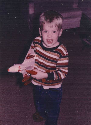 A young Willie McCool plays with a model airplane.