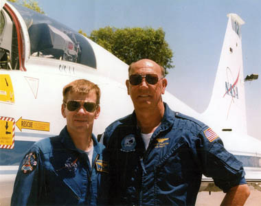 Willie and father Barry McCool, both Navy pilots, pose together in their flight uniforms.