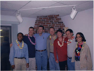 The crew poses for a photo during the family barbecue the night before the shuttle launched on its final mission.