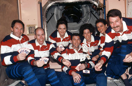 Rick Husband, center, poses in space with the crew of his first mission.