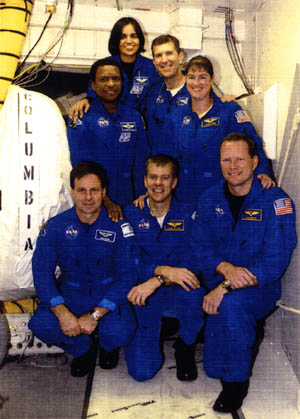 The Columbia crew poses outside the shuttle during training.