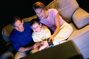 Mom & Dad watching intense show with child
