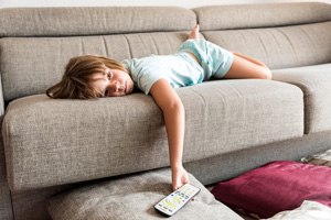 Child watching tv alone