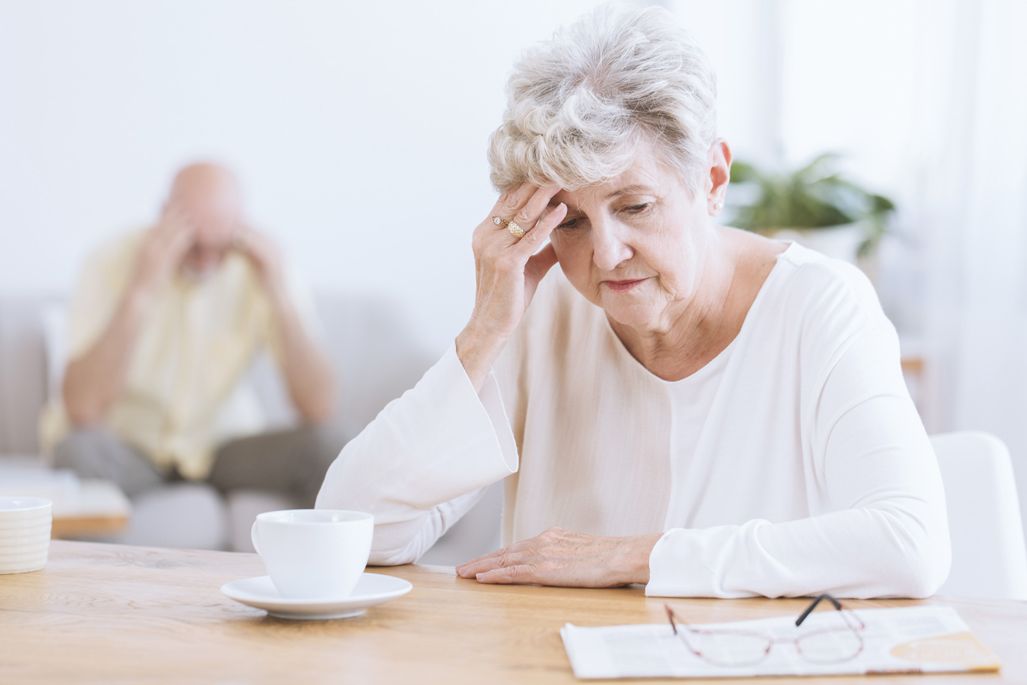 Elderly couple worried about finances.