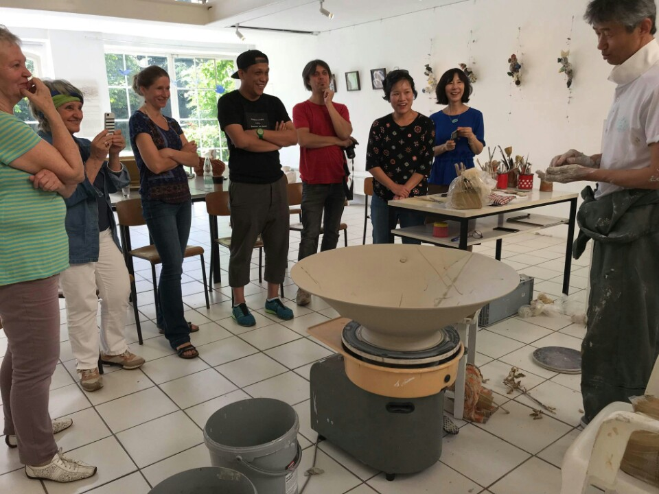 Professor Yoo leading an interactive ceramic art demonstration.