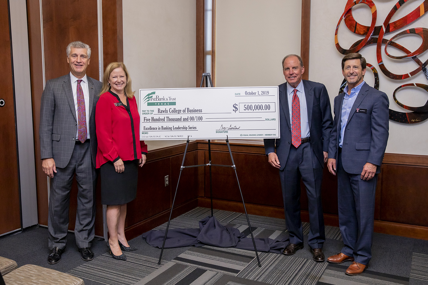 FirstBank & Trust Texas Rawls College of Business check presentation