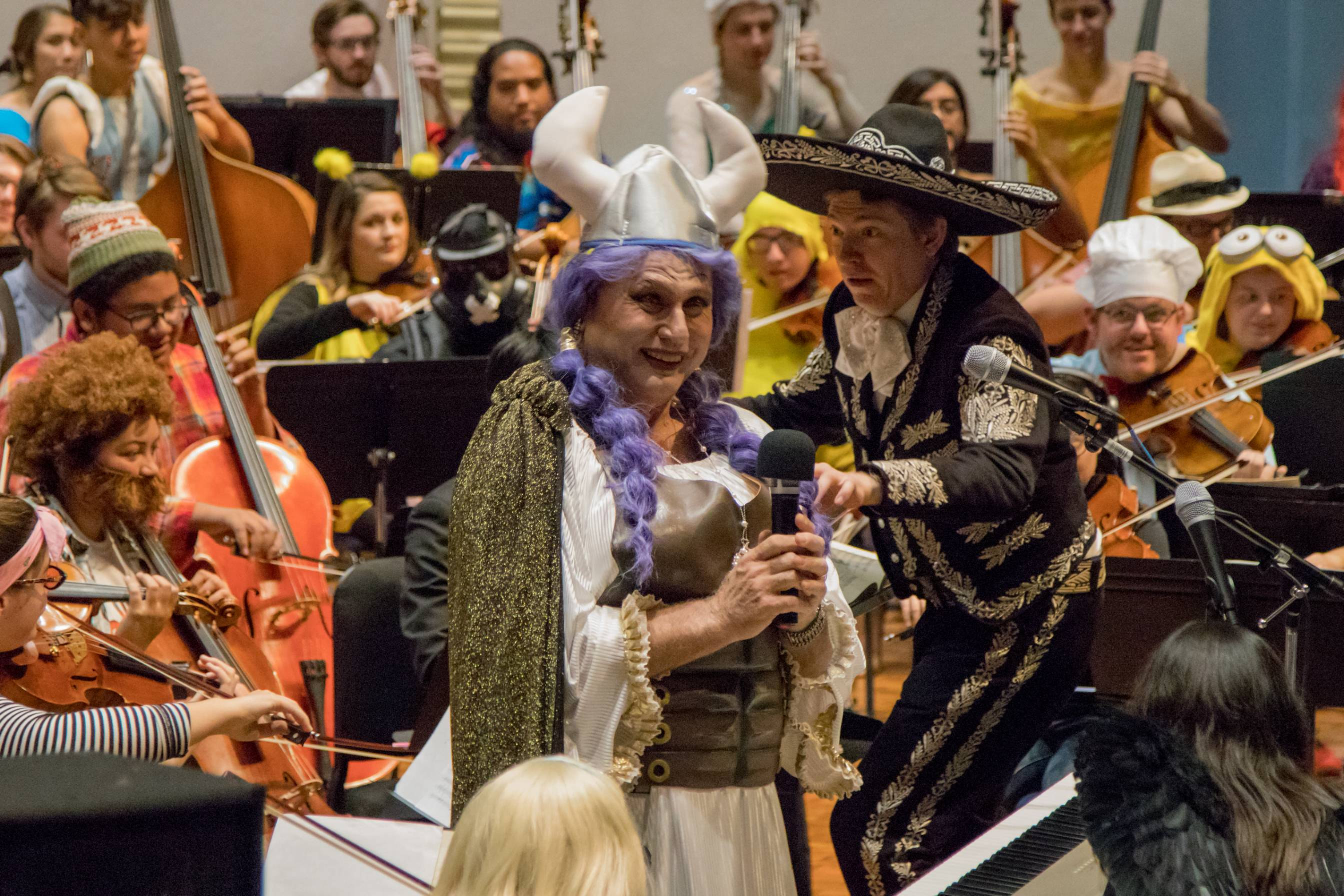 orchestra director and performer in costume